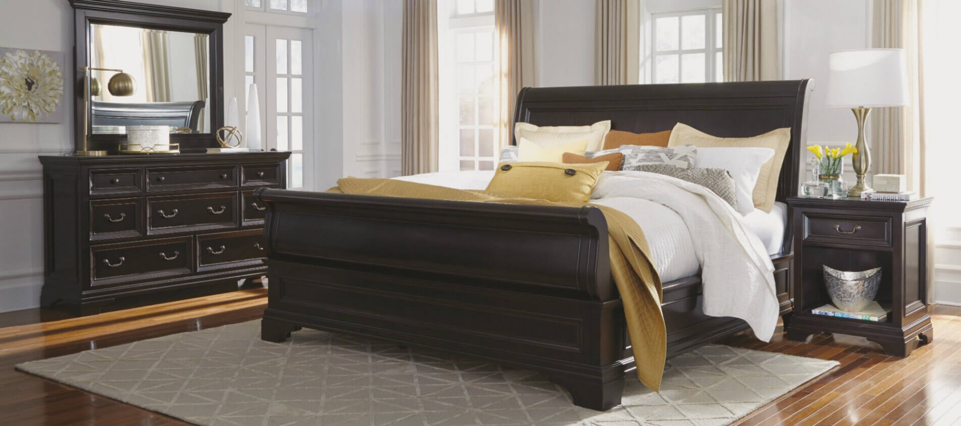 Camberly Bedroom Collection featuring bold structure with a dark wood finish