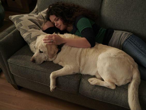 Girl and dog on sofa